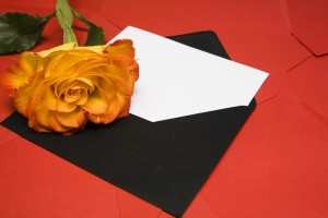 envelope and rose